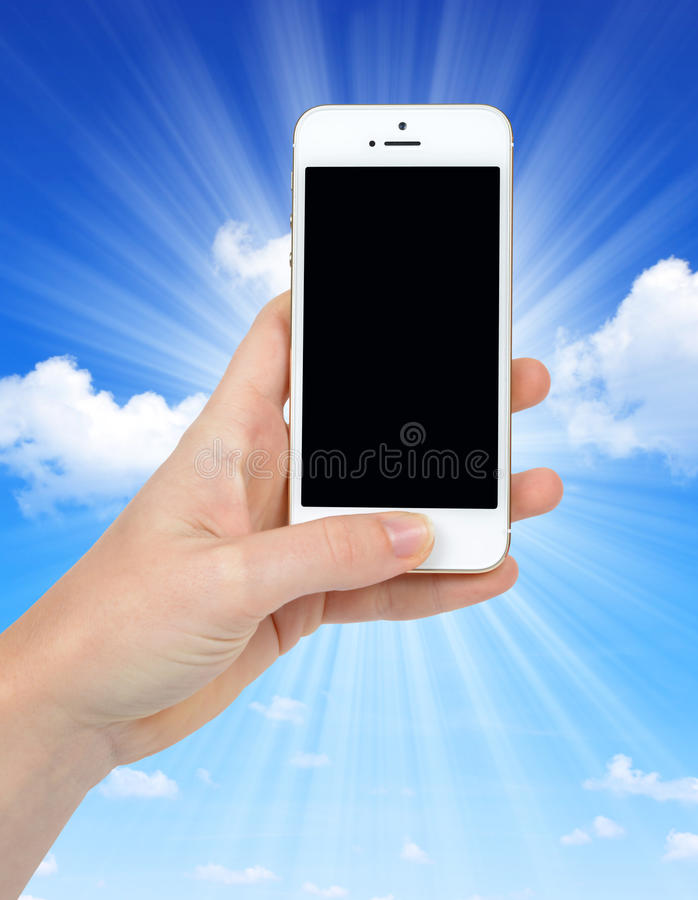 Woman Hand Holding Apple iPhone 5S Smart Phone royalty free stock photo
