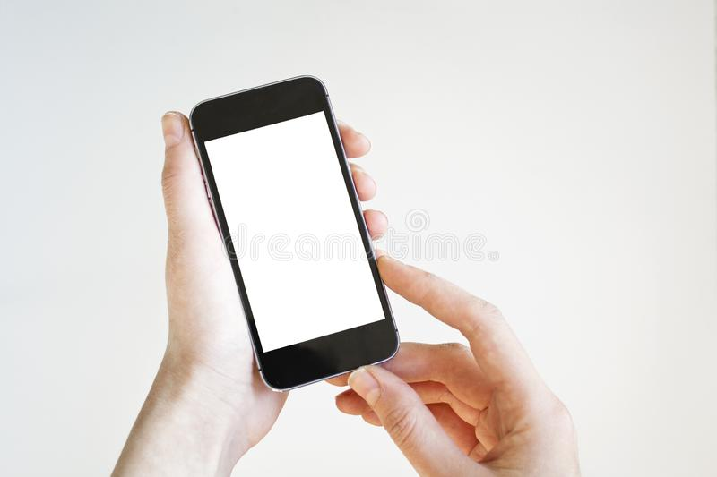 Woman hand holding black smartphone with blank screen, isolated on white background. stock images