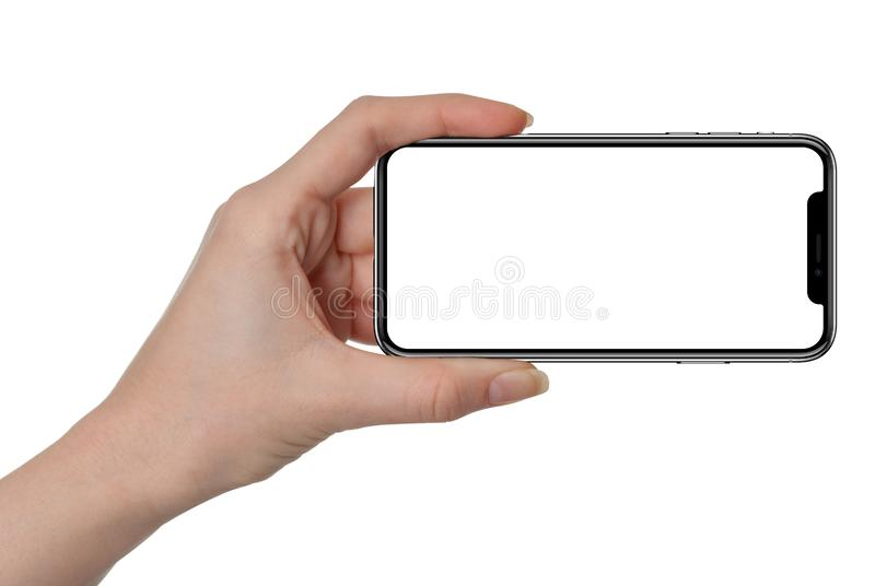 Woman hand holding black smartphone similar to iphone blank screen and modern frame less design - isolated on white background stock image