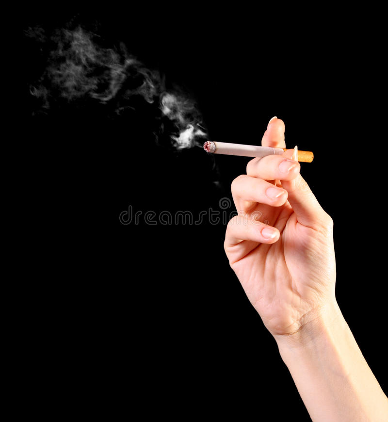 Woman hand holding a cigarette stock images