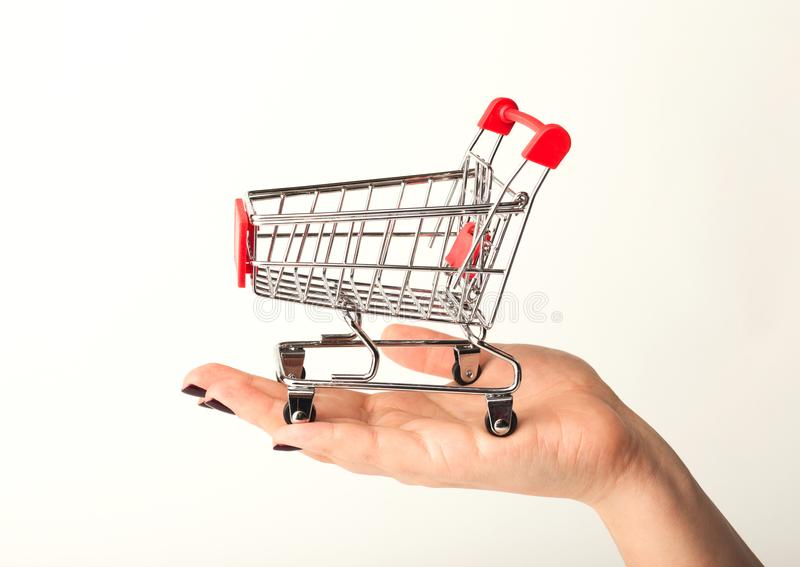 Woman hand holding empty shopping cart royalty free stock images