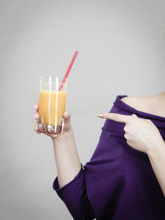 Woman hand holding fresh orange juice. Woman hand holding fresh orange grapefruit juice. Healthy fruit drink smoothies concept royalty free stock images