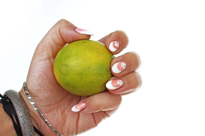 Woman hand holding lemon lime on isolated white cutout background. Studio photo with studio lighting easy to use for royalty free stock photography