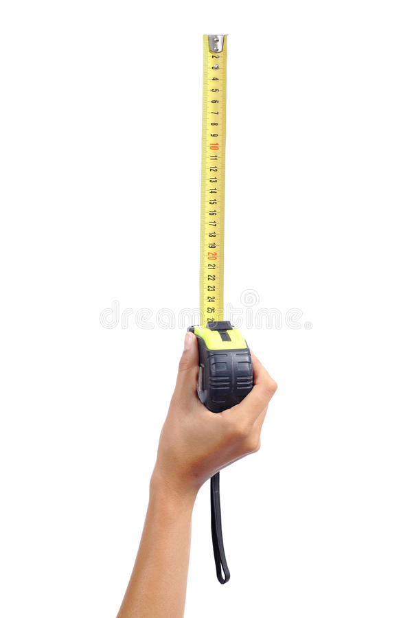 Woman hand holding a metallic tape measure royalty free stock photo