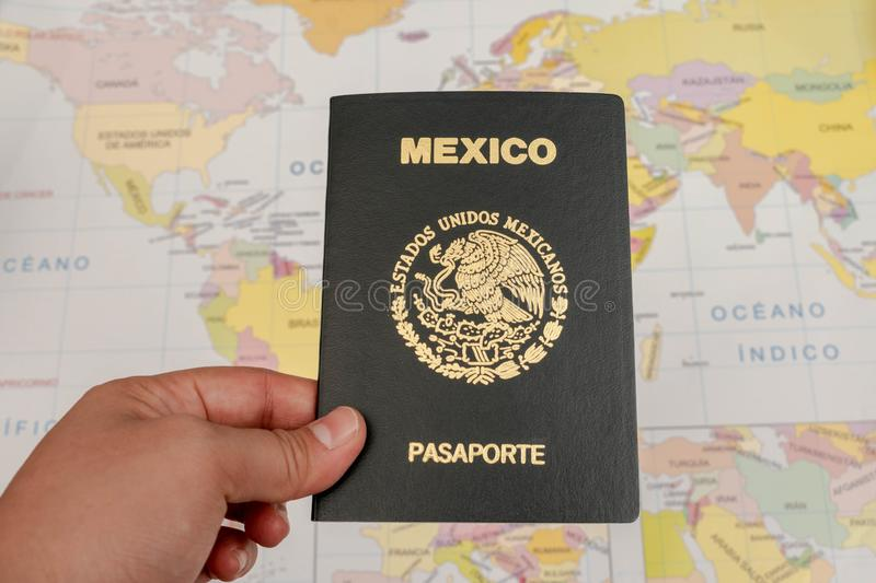 Woman hand holding a mexican passport stock photos