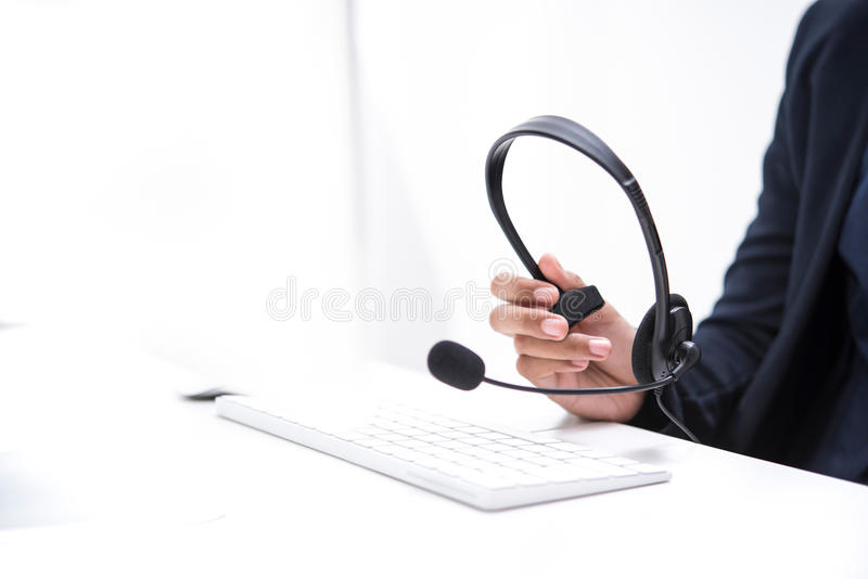 Woman hand holding microphone headset stock photo