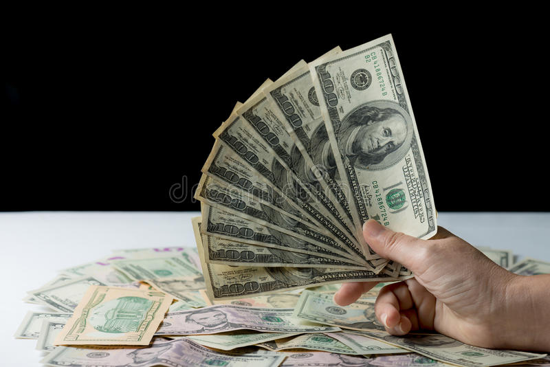 Woman hand holding money,bribery concept. Business woman giving stack of US dollar royalty free stock photos
