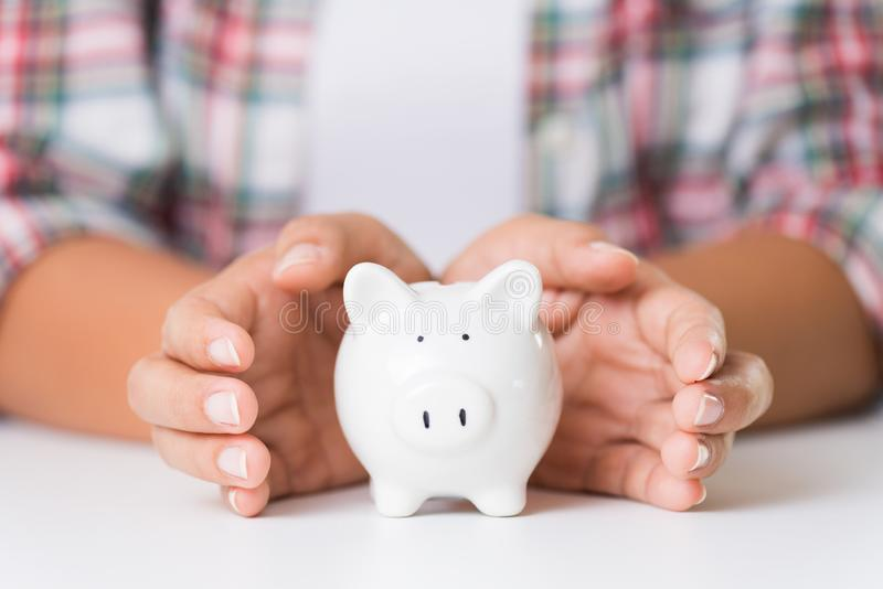 Woman hand holding piggy bank. Saving money wealth and financial royalty free stock image