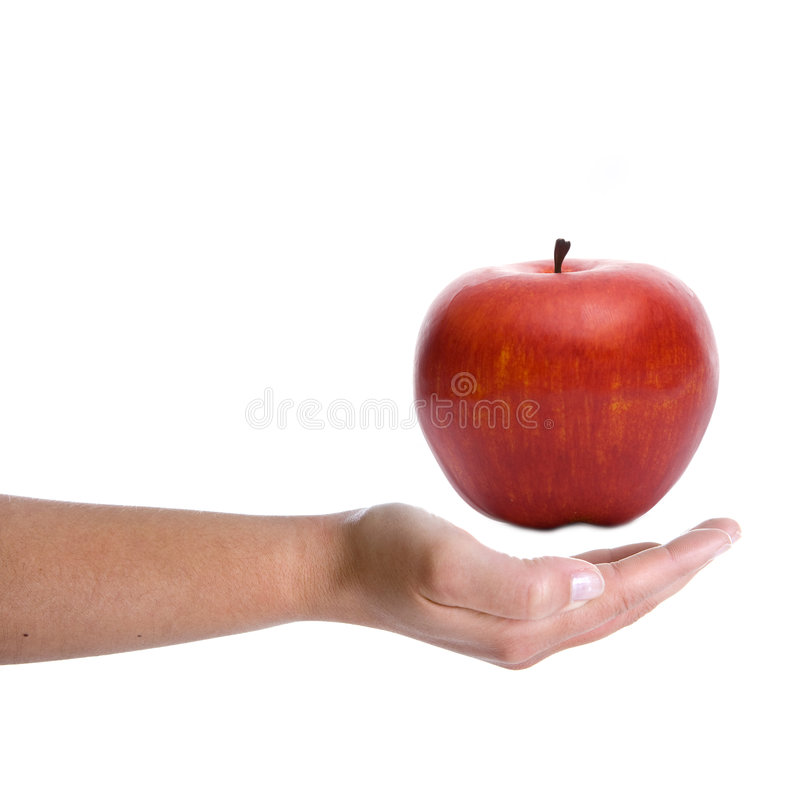 Woman hand holding red apple. Isolated on white background stock images