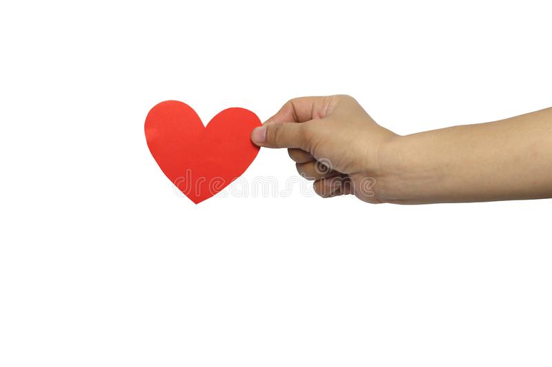 Woman hand holding a red paper heart shaped isolated on white background royalty free stock image