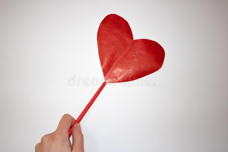 Woman hand holding a red paper heart for valentine`s day royalty free stock photography