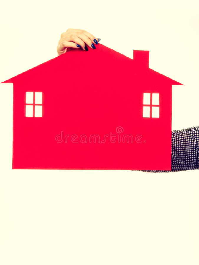 Woman hand holding red paper house royalty free stock photos