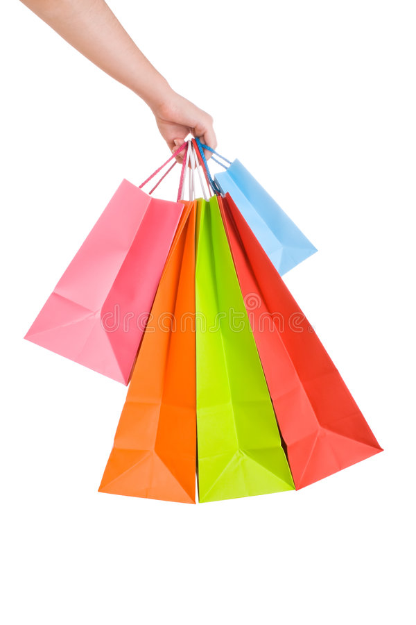 Woman hand holding several shopping bags royalty free stock image