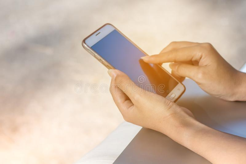 woman hand holding smartphone with big blank screen and modern f royalty free stock photography