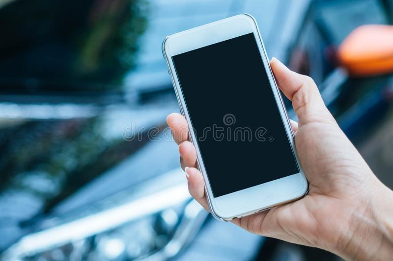 Woman hand holding smartphone. royalty free stock images