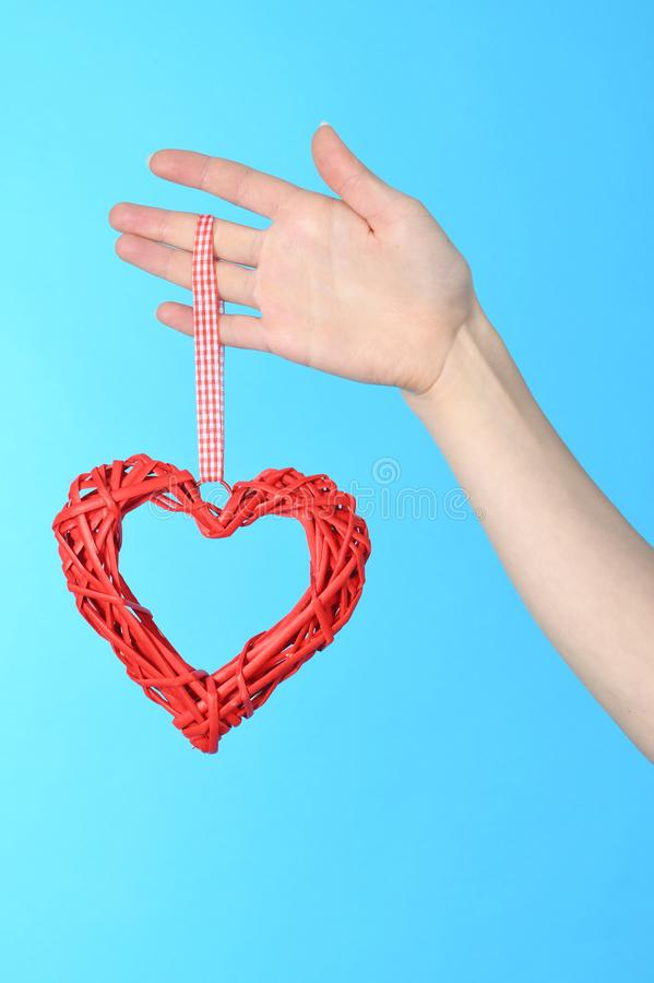 Woman hand holding symbol heart in hand stock photography