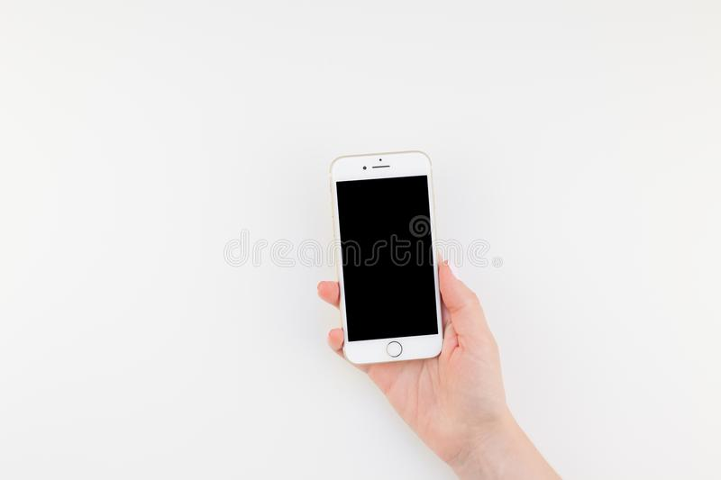 Woman hand with Iphone 7 stock image