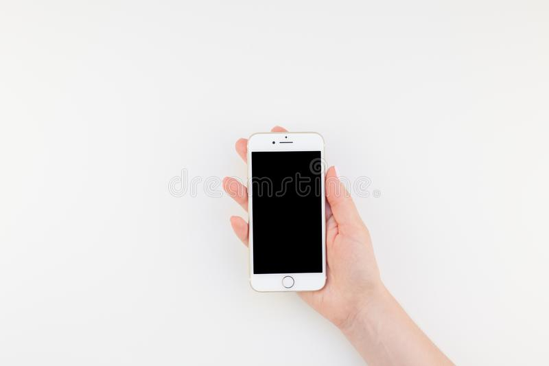 Woman hand with Iphone 7 royalty free stock photography