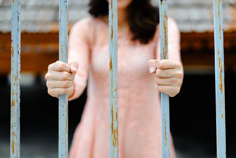 Woman hand on iron bar royalty free stock photos