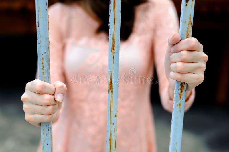 Woman hand on iron bar stock photography