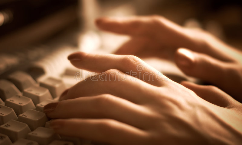 Woman Hand On Keyboard Royalty Free Stock Photo