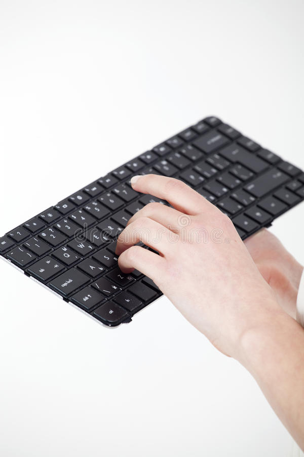 Woman hand on keyboard royalty free stock photos