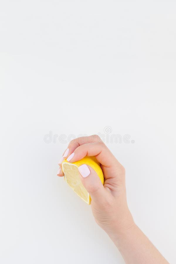 Woman hand with lemon royalty free stock photo