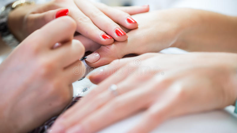 Woman hand on manicure treatment in beauty salon. Beauty parlour stock photography