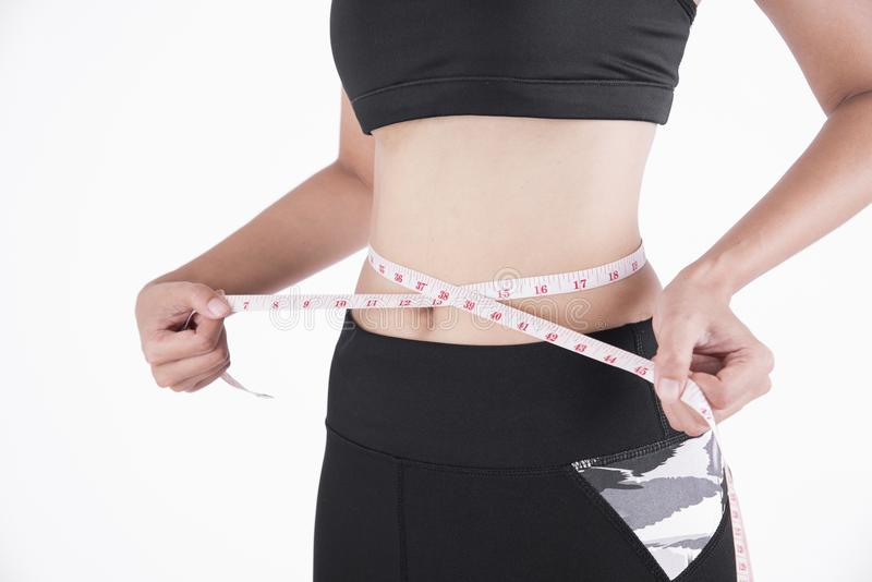 Woman hand measuring waist weight loss on white royalty free stock photography