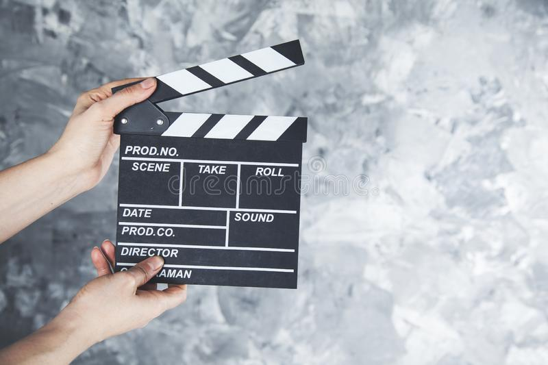 Woman hand movie clapper stock images