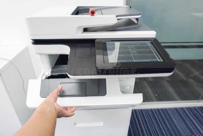 Woman hand open printer and put ink toner cartridge. Close up woman hand open printer and put ink toner cartridge stock photography