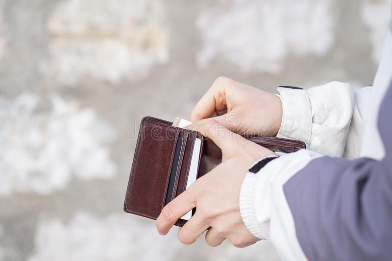 Woman hand open wallet and showing euro money stock image