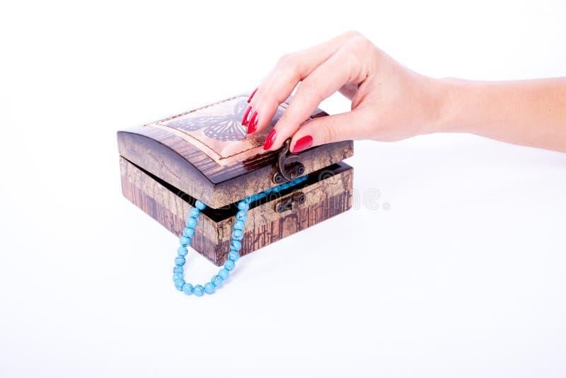 Woman hand opened box stock image