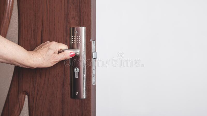 Woman hand opening a door in home stock photos