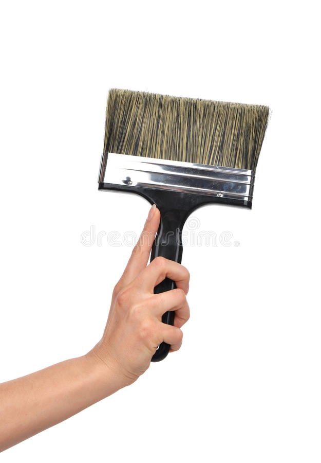 Woman hand with paint brush with plastic black handle i royalty free stock photos