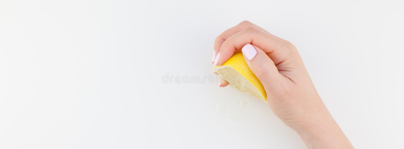 Woman hand with lemon stock photography