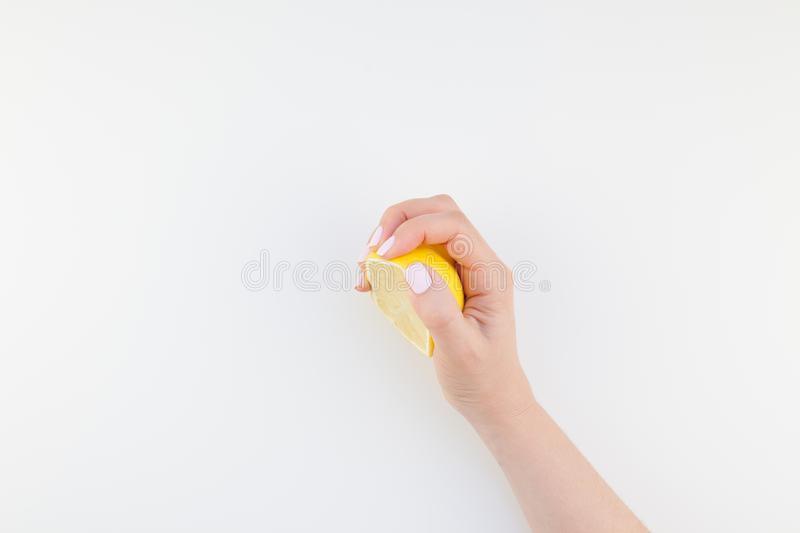 Woman hand with lemon royalty free stock photography