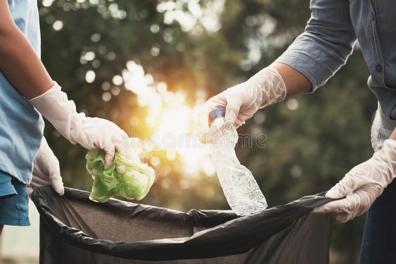 Woman hand picking up garbage plastic for cleaning. At park royalty free stock photography