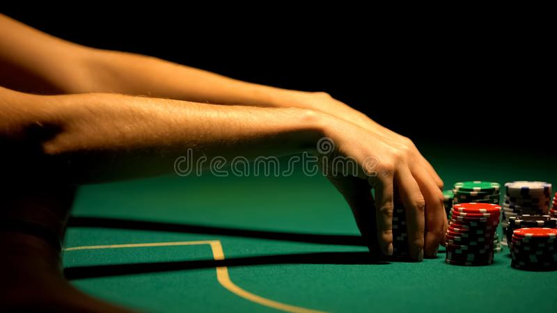 Woman hand playing poker, strategy and betting all-in, bluffing, closeup stock image