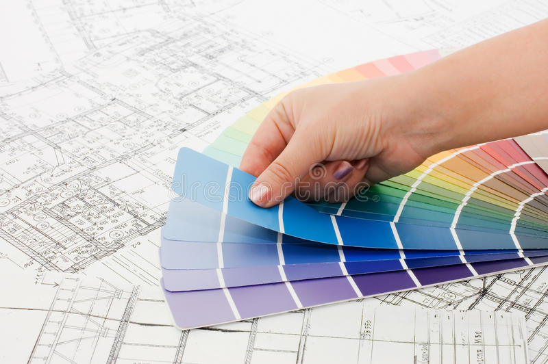 Woman hand pointing to a sample color chart stock photos