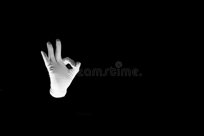 Woman hand pointing up okay, yes, accepting hand sign, studio isolated . Human hand gesture is all right everything is OK. Isolated. on black background royalty free stock image