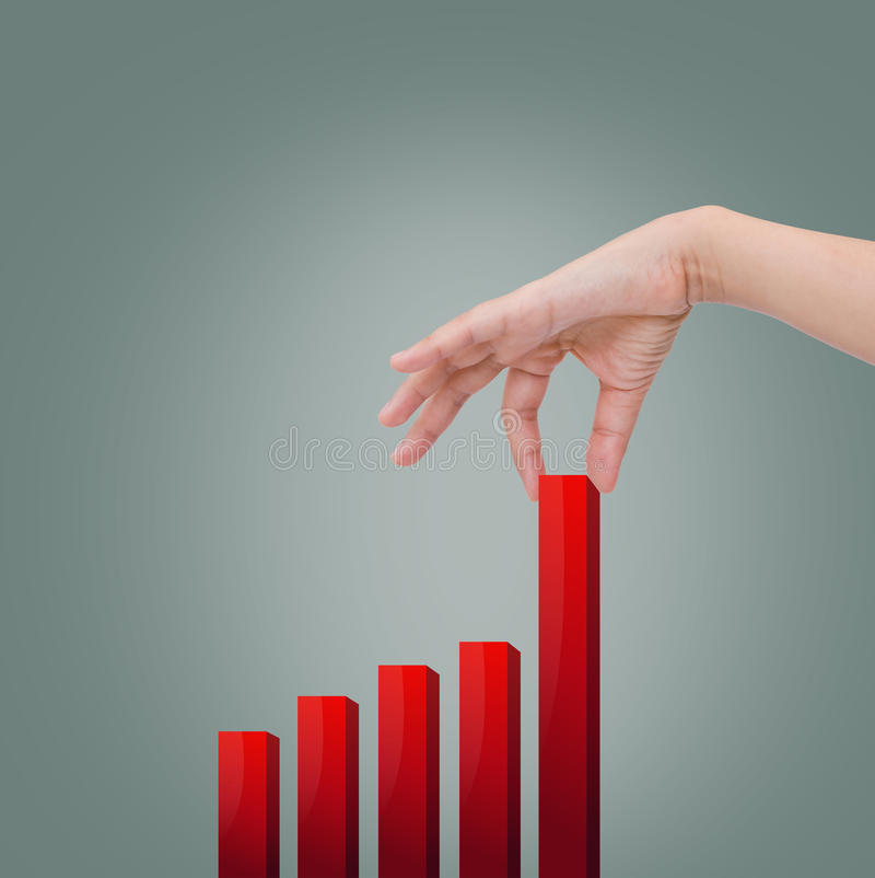 Woman hand pulling up a bar from a graph royalty free stock images