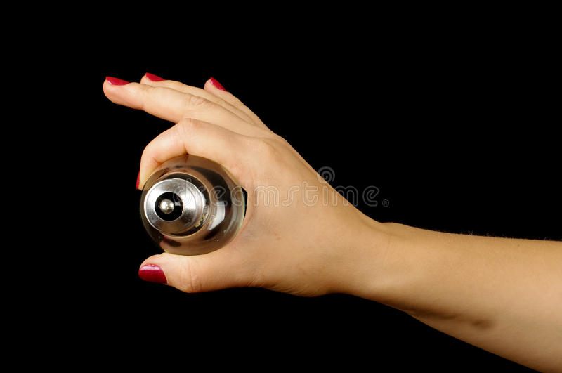 Woman hand showing plinth of the lamp. Female hand holding different objects isolated on the black background stock photos