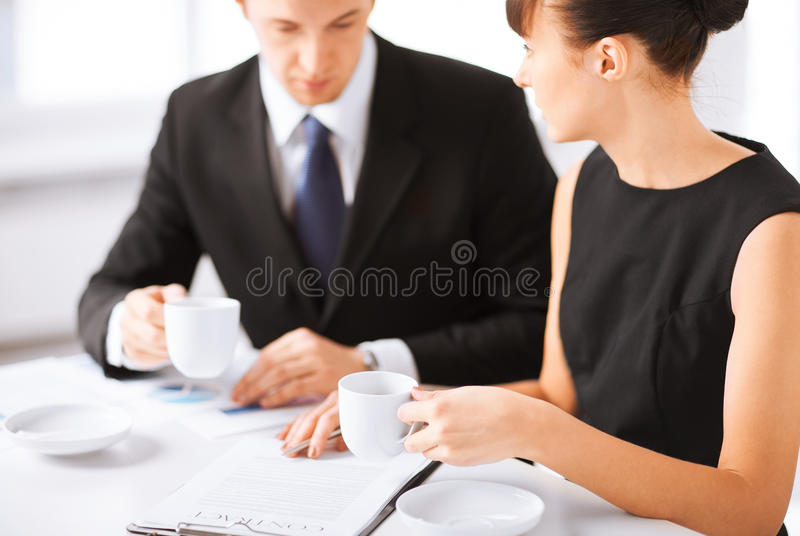 Woman hand signing contract paper royalty free stock images