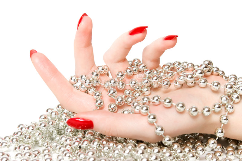 Woman hand with silver glassbeads royalty free stock images
