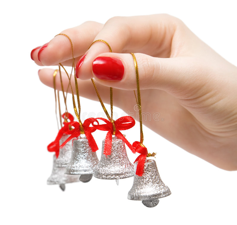 Woman hand with small bells on fingers royalty free stock photo