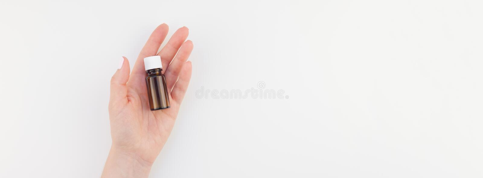 Woman hand with small glass bottle isolated royalty free stock image