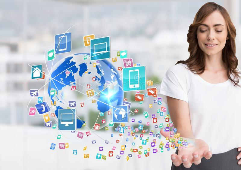 Woman with hand spread of with application icons coming up form it and earth Blurred office backgr. Digital composite of woman with hand spread of with royalty free stock photos