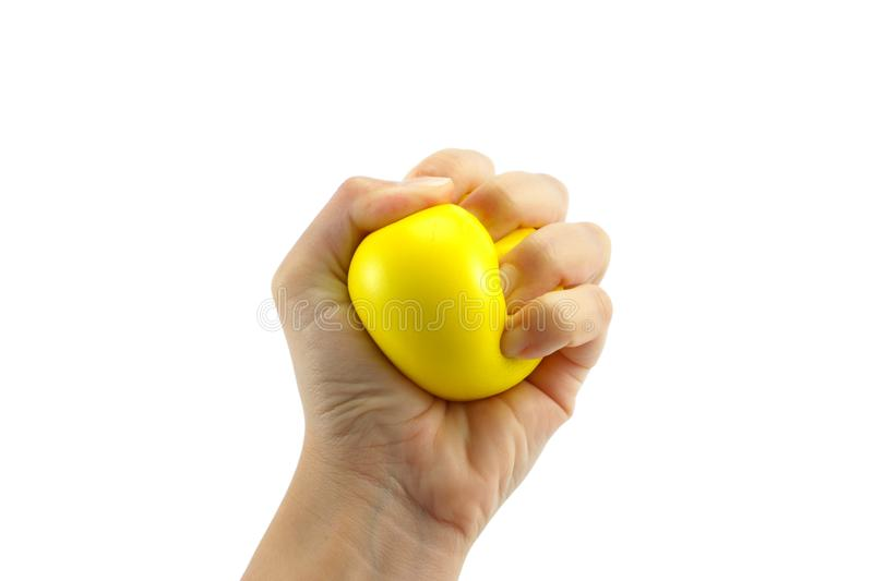 Woman hand squeezing a stress ball on white background stock photo