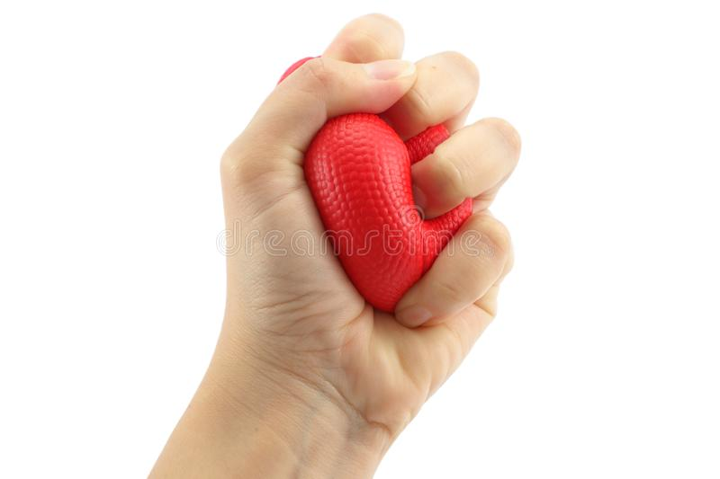 Woman hand squeezing a stress ball royalty free stock images